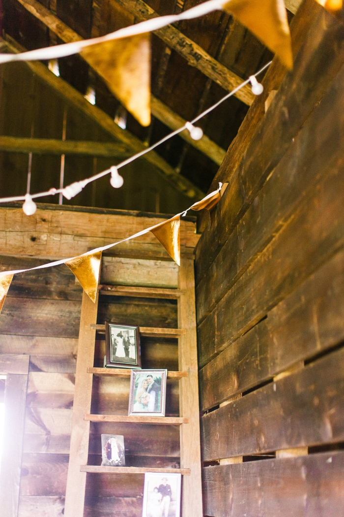 Family wedding portraits and pennant flags in the corn crib at Nipmoose Barns